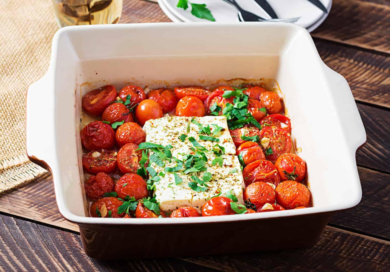 Preparation of ingredients for fetapasta. Trending Feta bake pasta recipe made of cherry tomatoes, feta cheese, garlic and herbs.