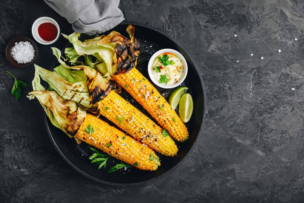 Roasted or grilled sweet corn cobs with garlic butter and lime, Is It Better To Grill Corn With Or Without The Husk?