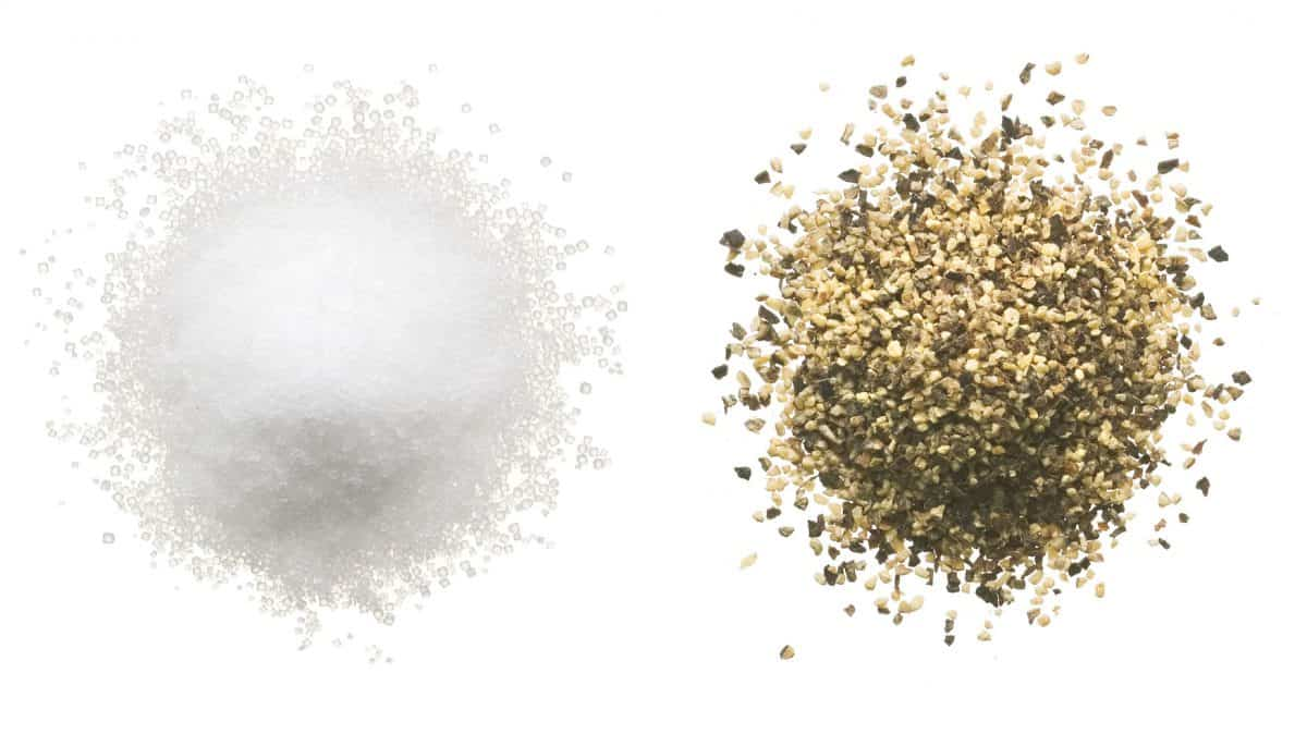 Salt and pepper on a white background