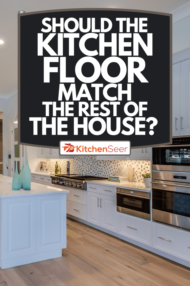 A large spacious kitchen with stainless steel appliances, Should The Kitchen Floor Match The Rest Of The House?