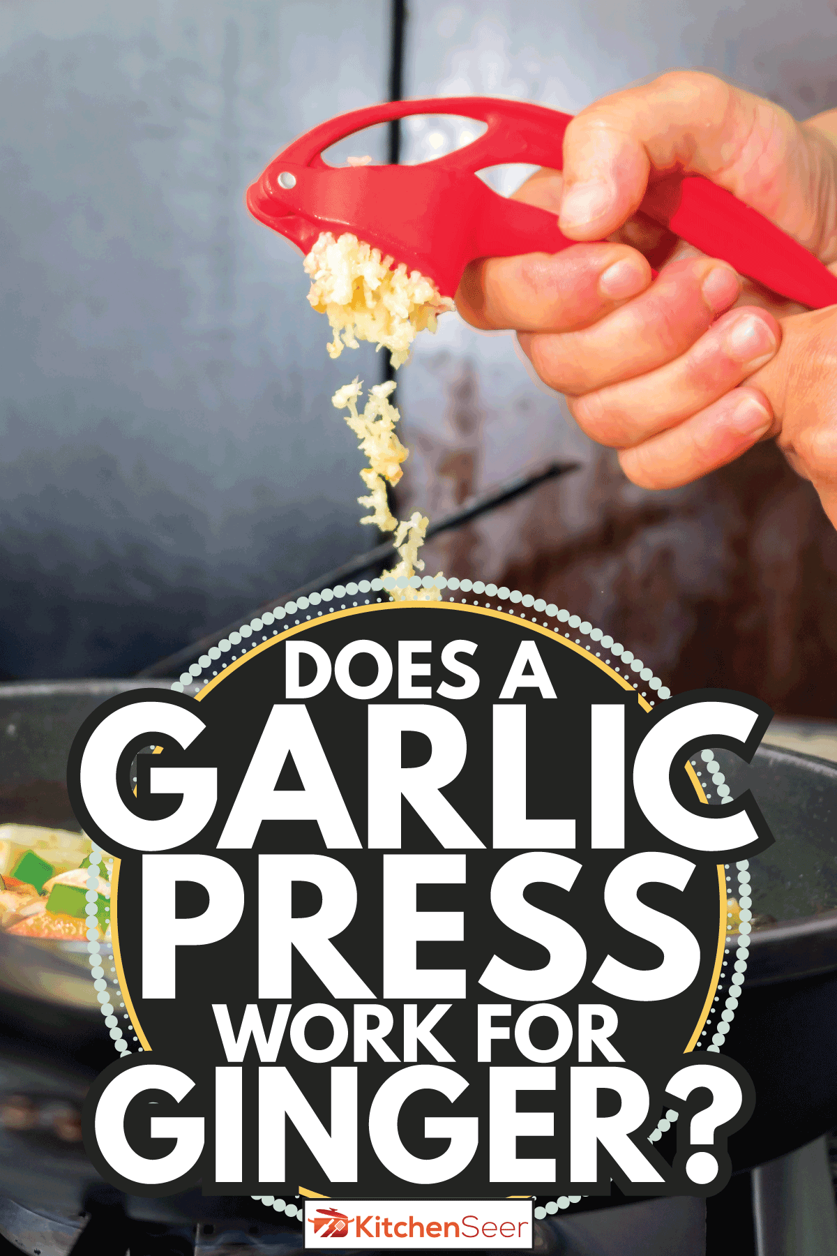 hand crushing garlic with a kitchen tool and pouring it over the stew in a pan. Does A Garlic Press Work For Ginger