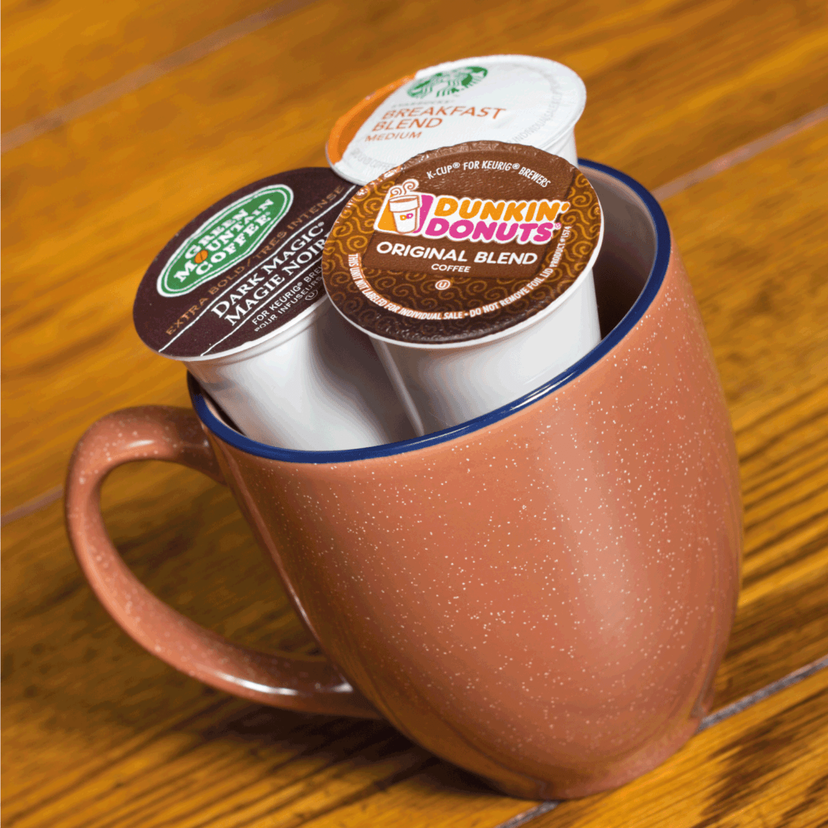 k-cups inside a large coffee mug on a wooden table