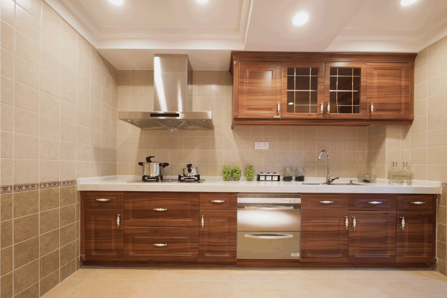 kitchen with wooden cabinets, floor to ceiling tile, marble countertop, and painted floor