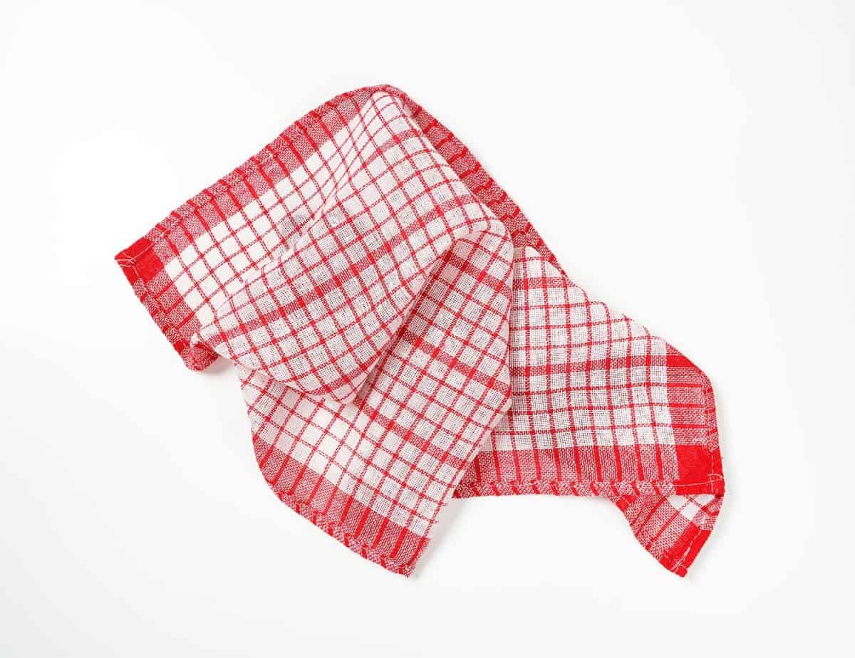 Red and white crumpled dish towel