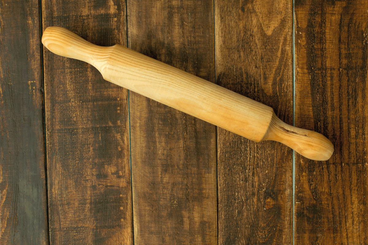 rolling pin on a wooden table.16 Types Of Rolling Pins To Know