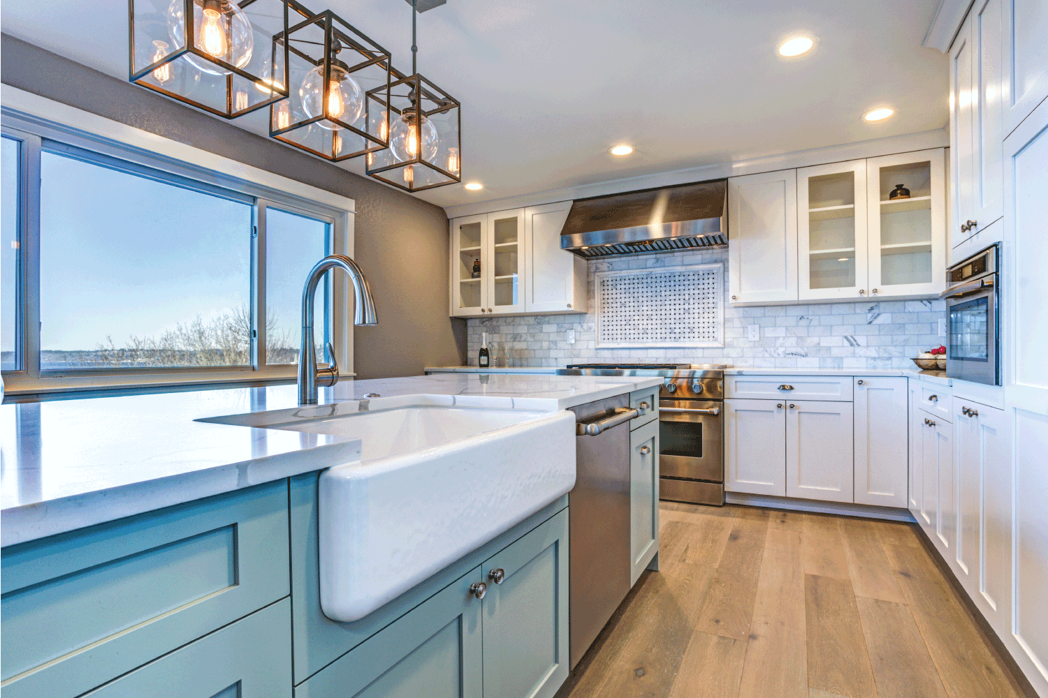 Beautiful kitchen room with green island and farm sink. White, Natural Wood, And The Color You Love