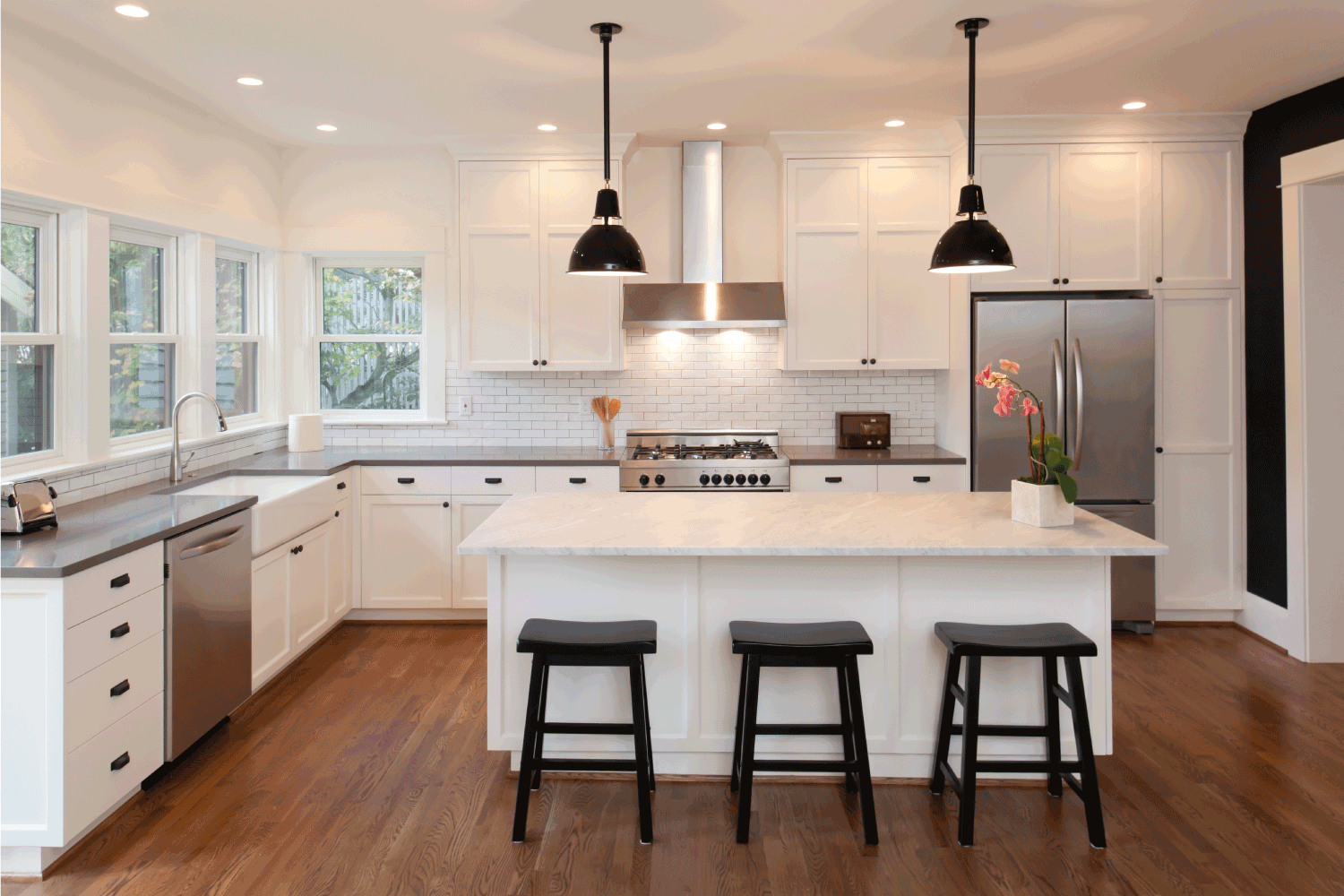 Beautiful, new kitchen in luxury home. different color floor and countertop