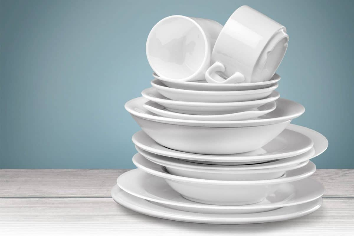 Clean corelle plates and cups isolated on background