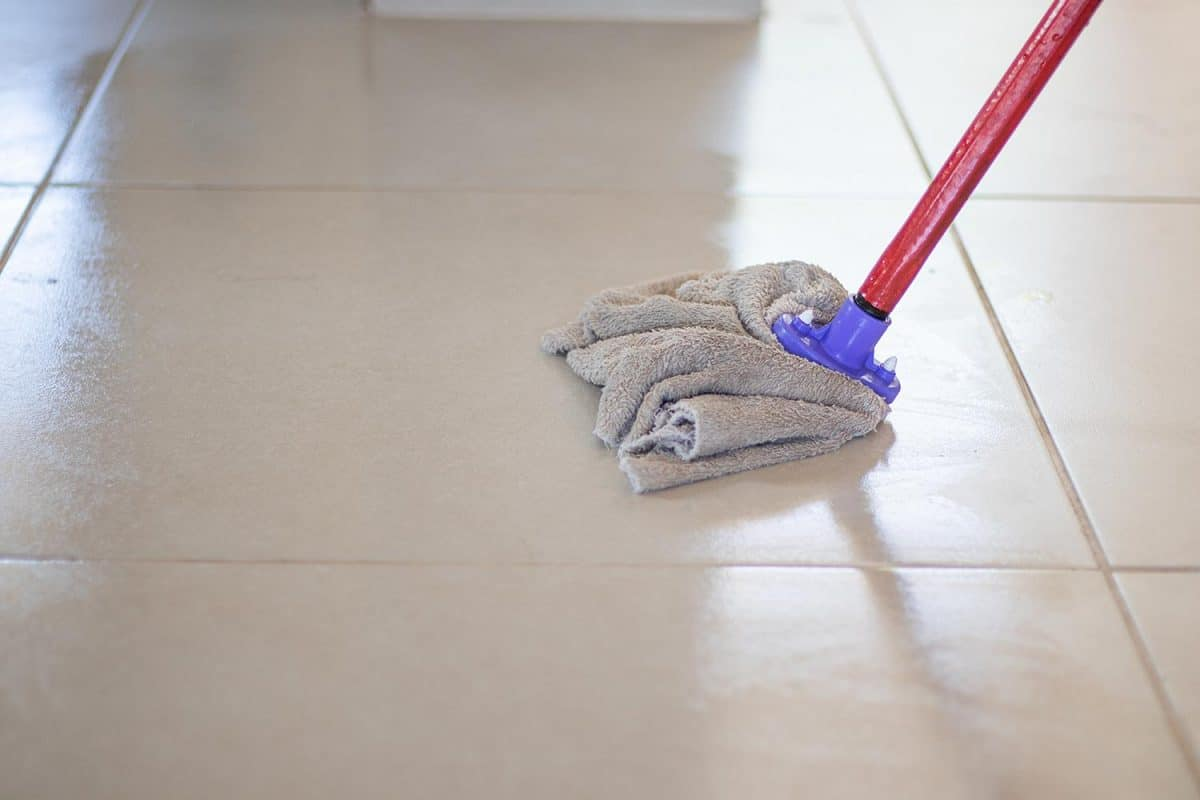Cleaning the floors with a mop