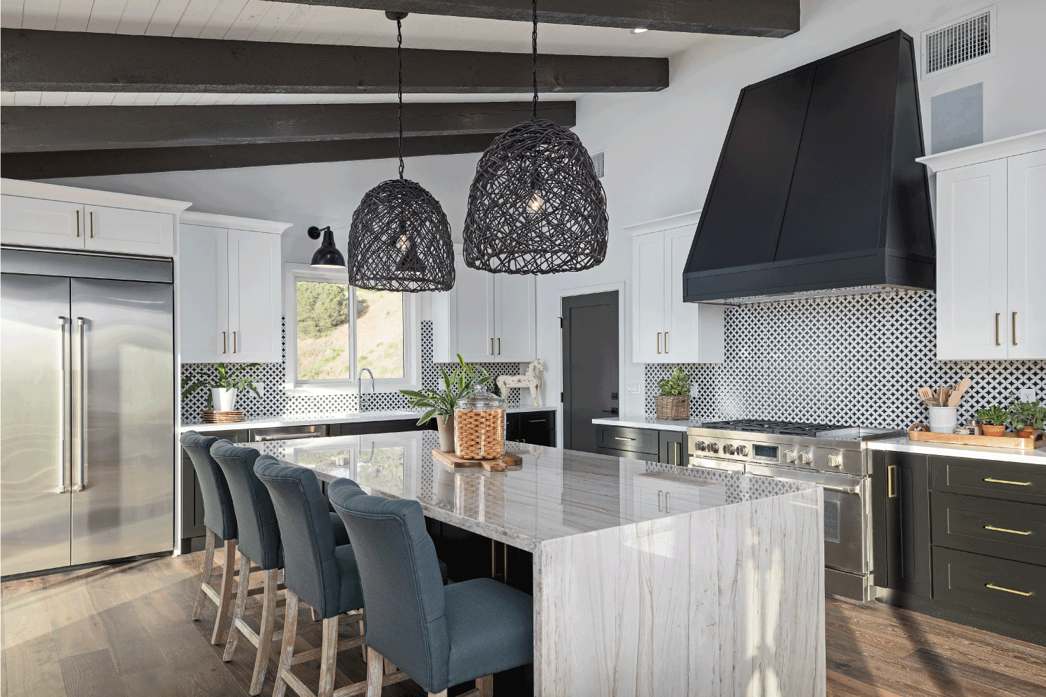 Color photo of a beautiful modern kitchen with gray and white in various combinations