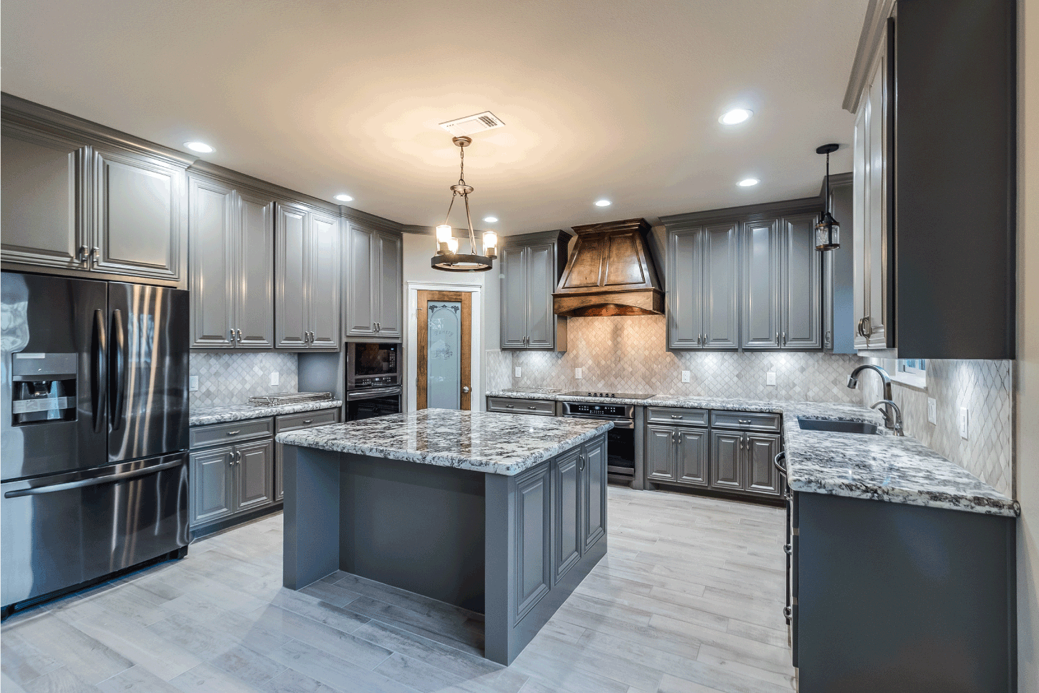 Dark grey cabinetry in large enclosed kitchen. gray tones concept
