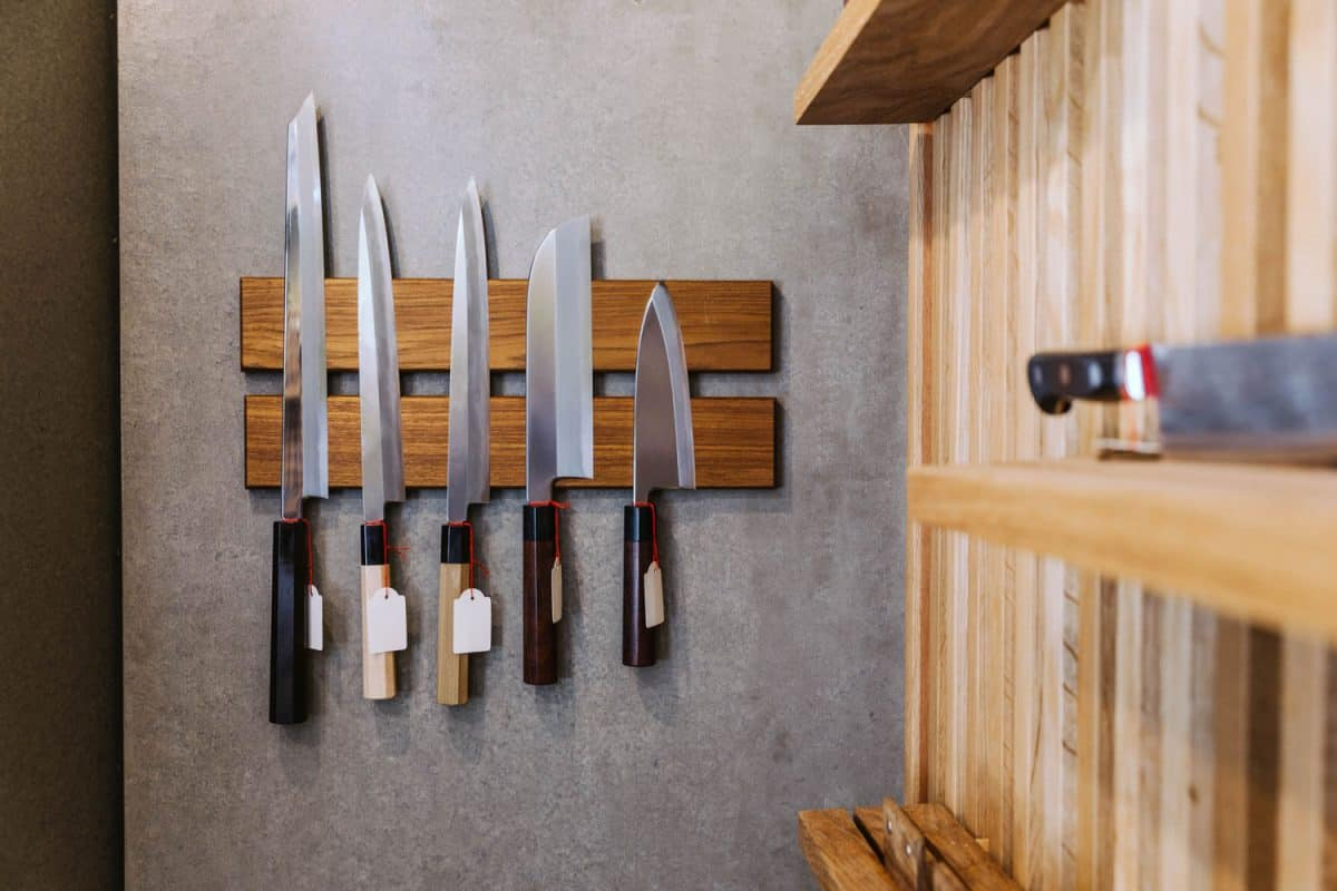 Different butchers knives hanged on the wall