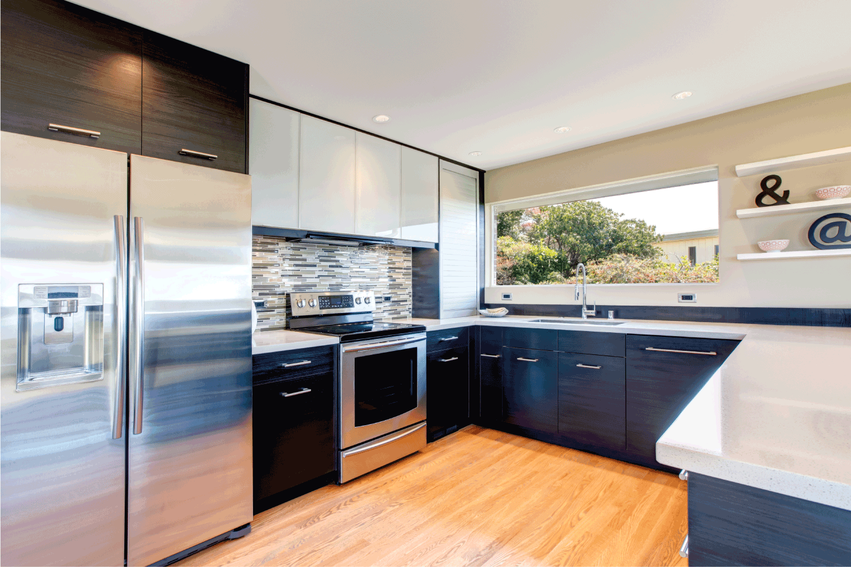 Elegant kitchen room with black wood storage combination accopmlished with stoned backsplash and decorative wall shelf