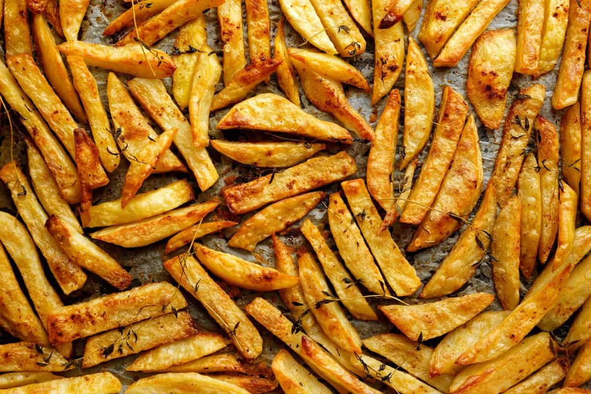 Homemade french fries with addition herbs