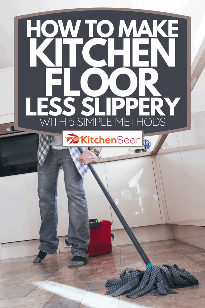 A low angle view of a man mopping the floor in his kitchen, How To Make Kitchen Floor Less Slippery [With 5 Simple Methods]
