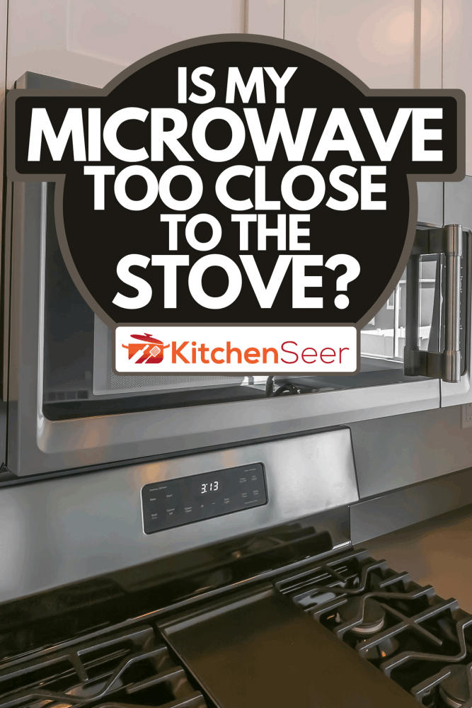 A close up of the microwave and wooden cabinets mounted on the wall, Is My Microwave Too Close To The Stove?