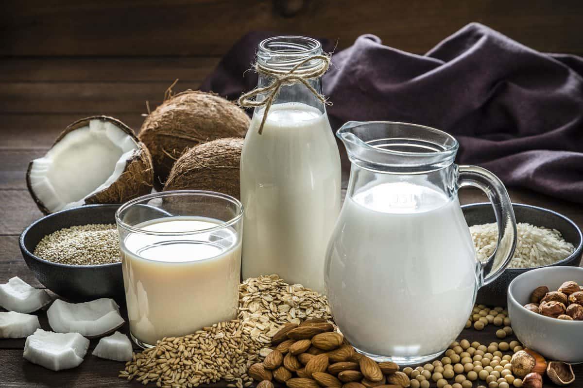 Jars and pitchers of vegan milk