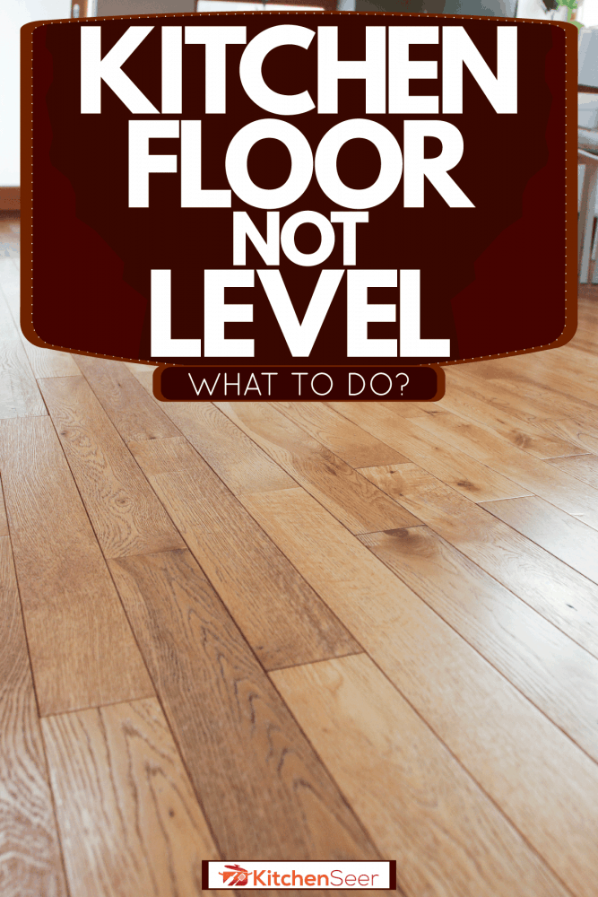 A wooden kitchen flooring with white chairs and a wooden table, Kitchen Floor Not Level - What To Do?