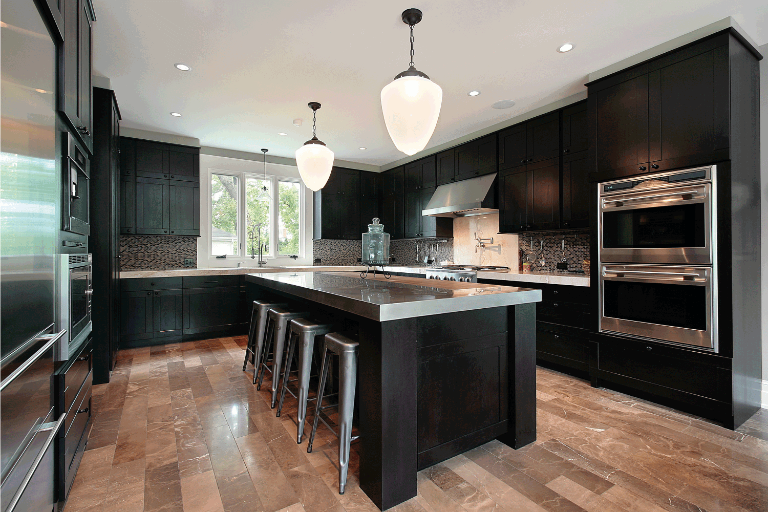 Kitchen with dark wood cabinetry. dramatic black concept