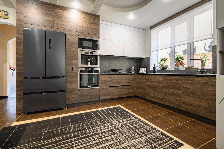 Modern luxurious dark brown, gray and black kitchen interior. modern lines concept.