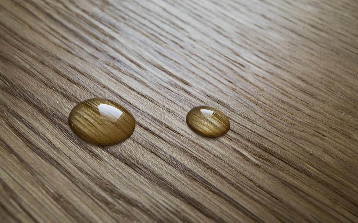 Oil drop on a wooden oak surface