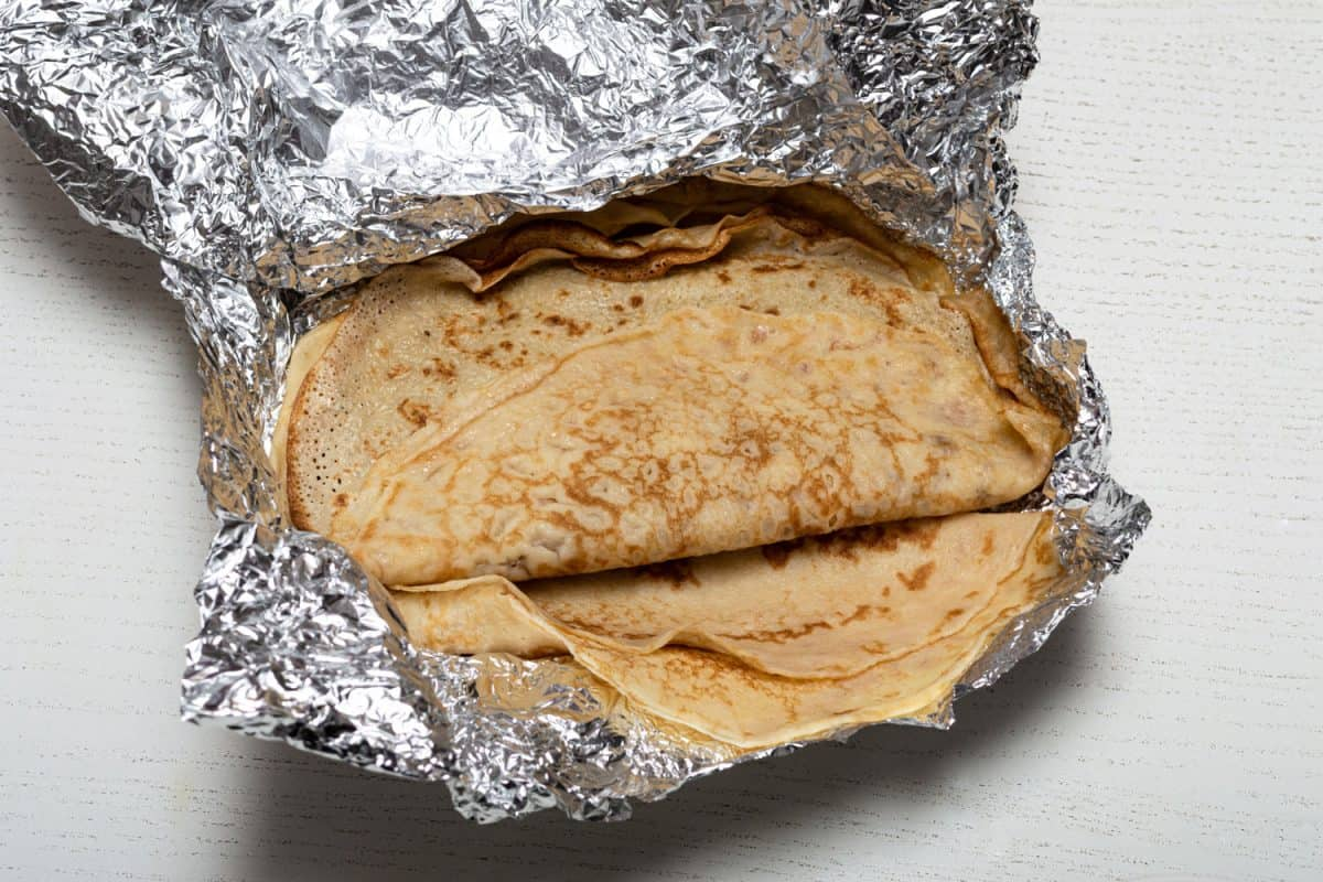Pancakes wrapped in foil to keep warm