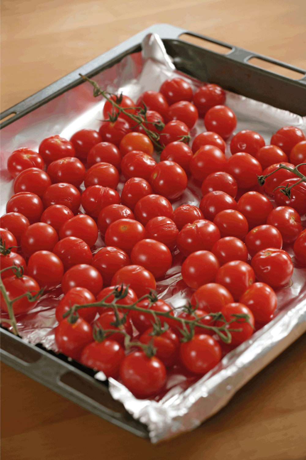 Roasted cherry tomatoes in a baking pan