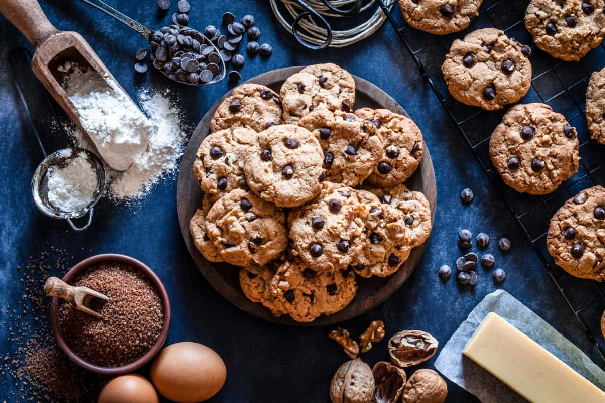 Top view of a wooden plate filled with chocolate chips cookies placed at the center of the frame, Should You Melt Butter For Chocolate Chip Cookies?
