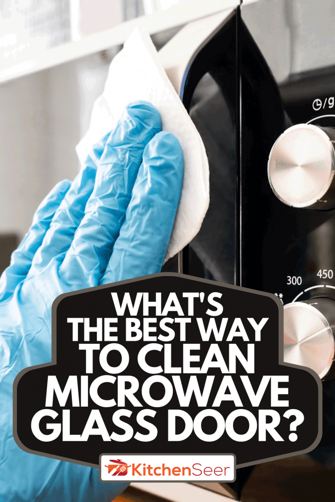 A man wiping microwave oven, What's The Best Way To Clean Microwave Glass Door?