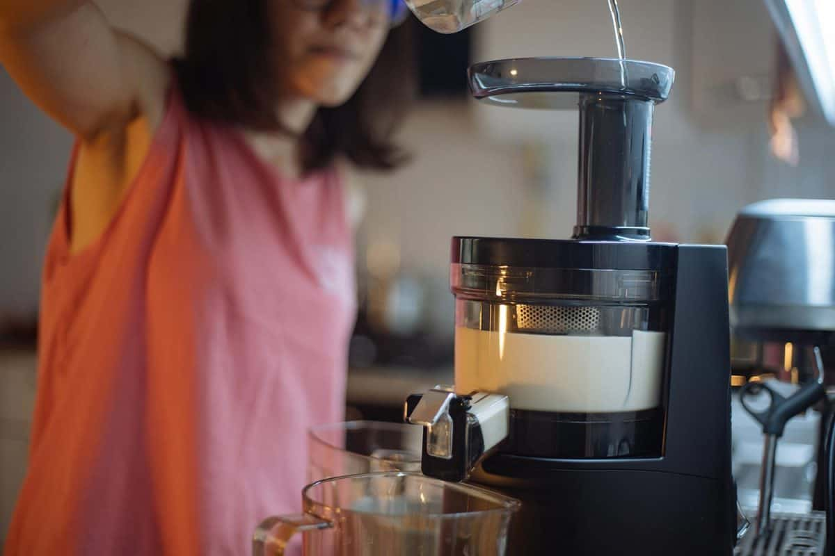 Woman making home made almond milk