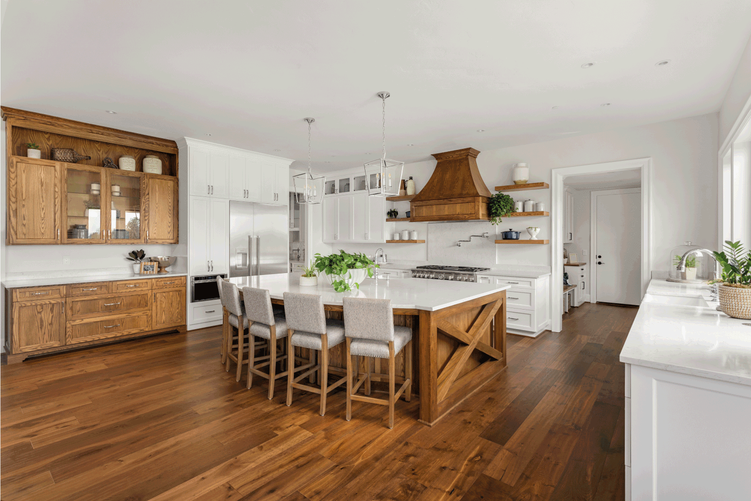 kitchen in newly constructed luxury home with wood tones and whites