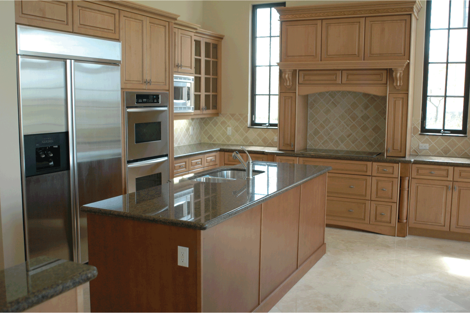 light and dark wood cabinets in a bright kitchen