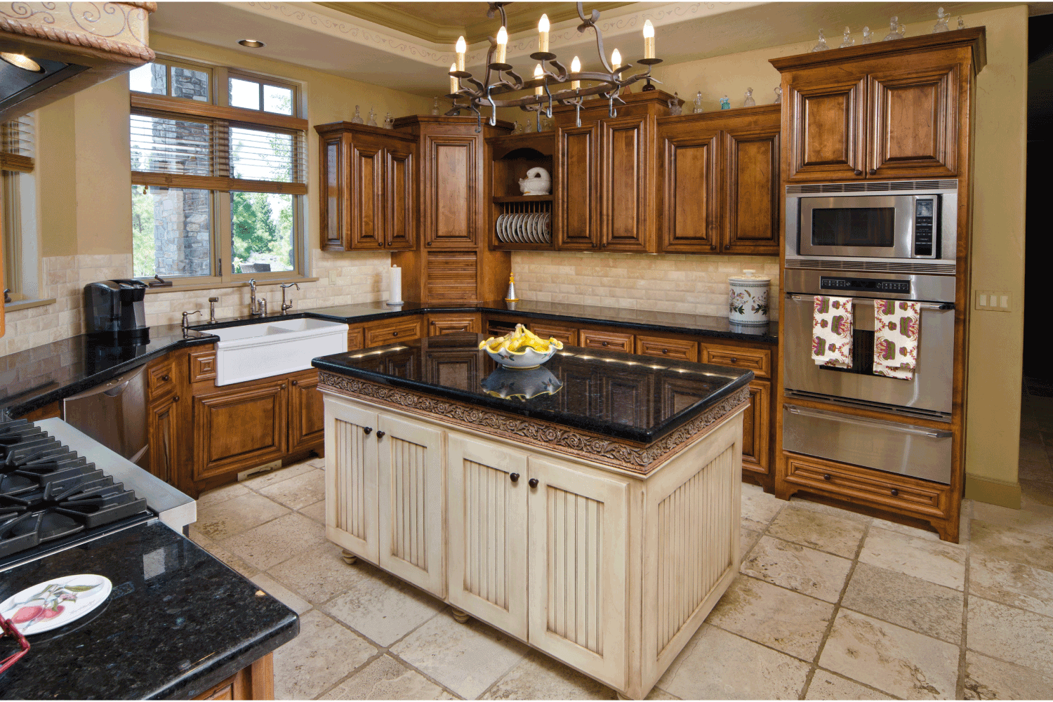 two tone farmhouse kitchen with island, granite countertops, wooden cabinets