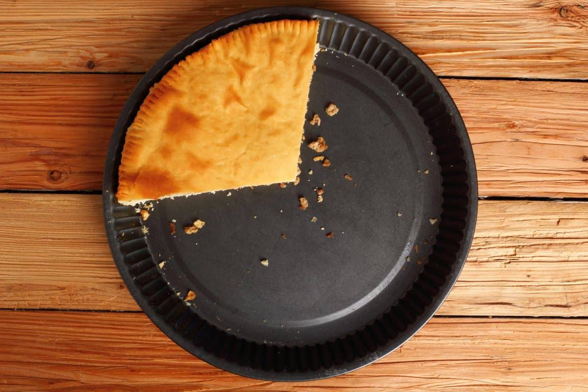 A big slice of freshly baked meat pie, How Deep Is A Pie Pan? [Inc. Deep Dish]