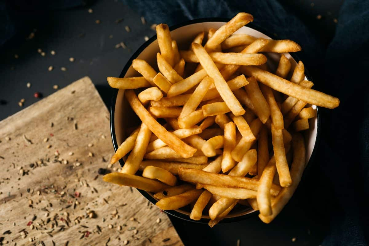 A bowl filled with fresh french fries, How Big Is A Serving Of French Fries? [And How Many Fries Are In One?]