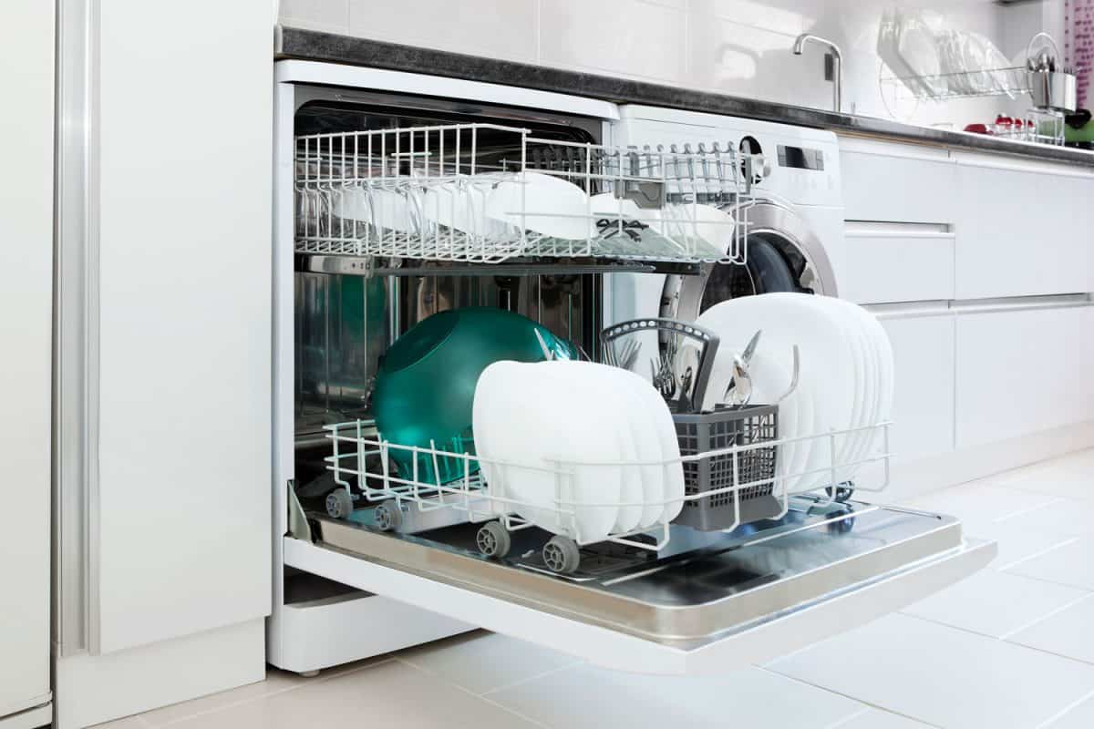 A dishwasher with clean plates, utensils and bowls, Bosch Dishwasher Not Starting - What To Do?