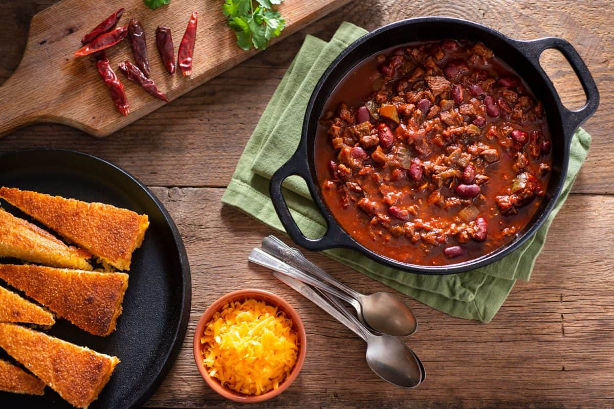 A pot of chilli and other side dishes on the side, Can Dutch Ovens Go In The Microwave?