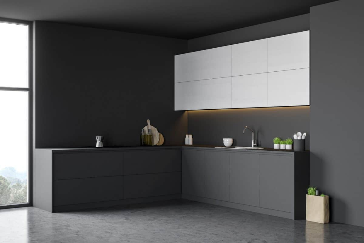 A small minimalist inspired kitchen with white floating cabinets and black lower cabinets