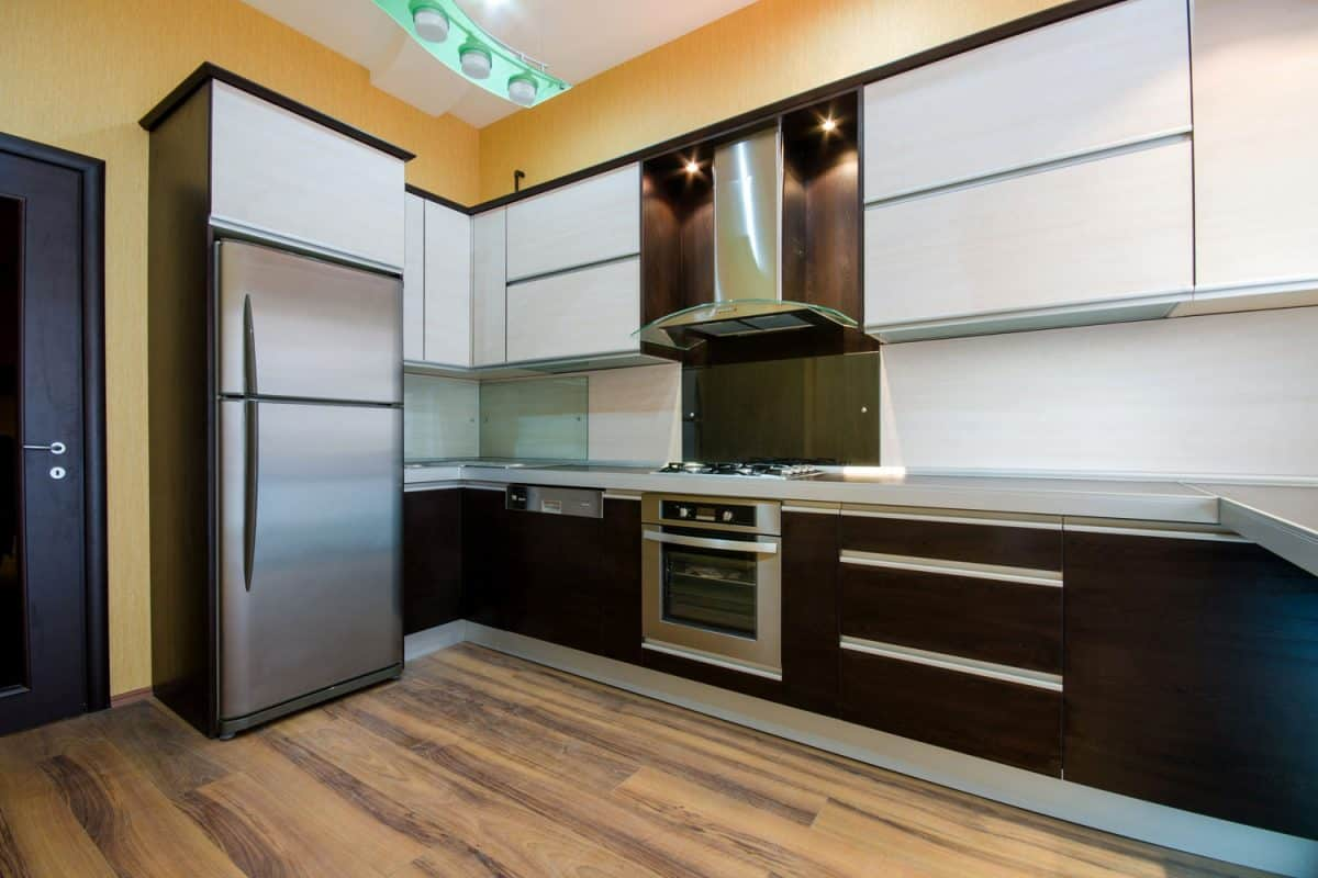 A stainless steel fabricated kitchen with long span floating and lower cabinets