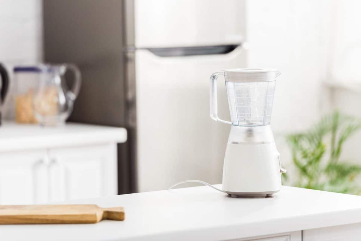 A white blender on top of a granite kitchen countertop, Cuisinart Blender Not Working - What To Do?