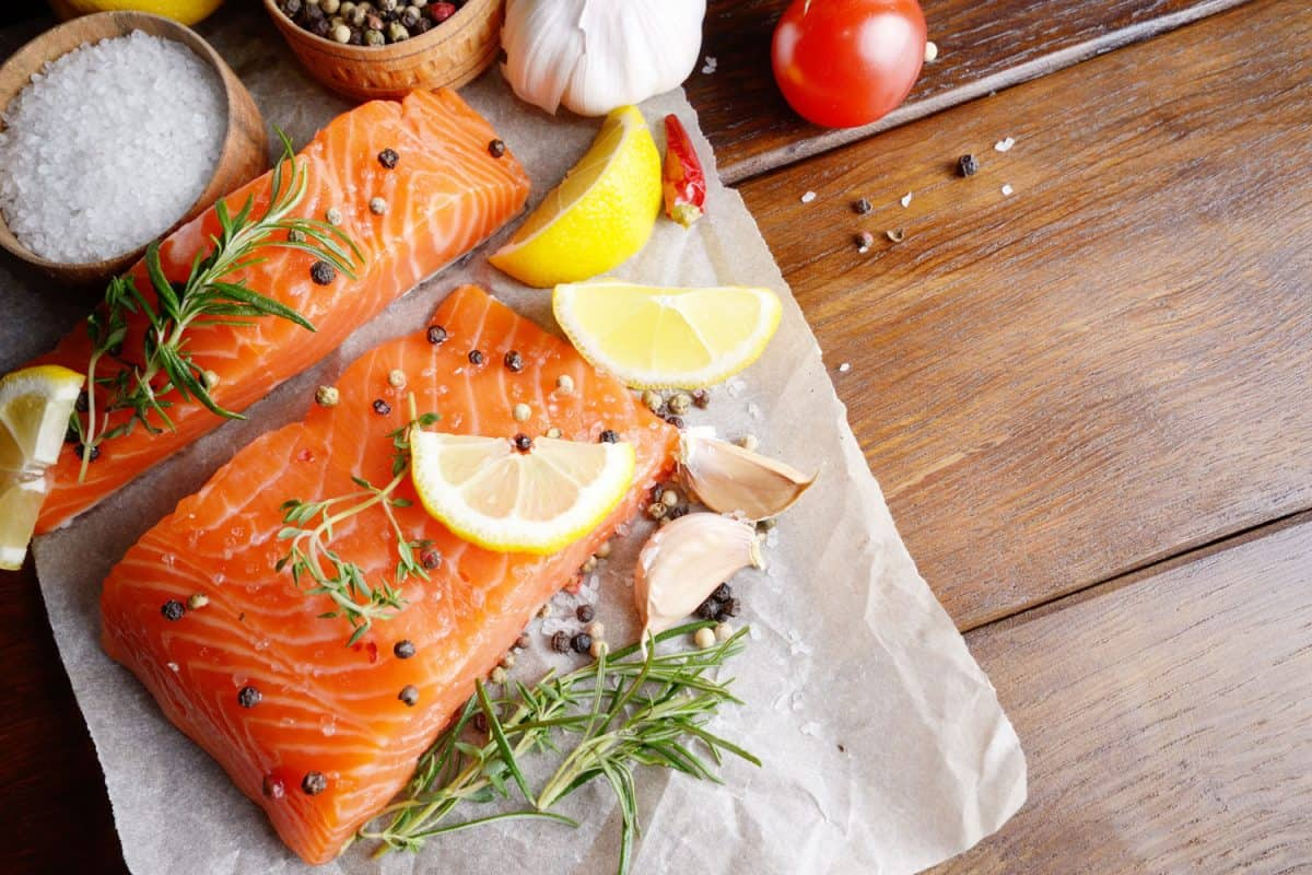 Baking a big chunk of salmon with oregano, pepper and citrus, At What Temperature Should You Bake Salmon?