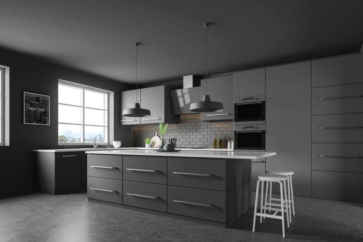 Black luxurious inspired kitchen area with black tiles, black kitchen cabinetries, and black dangling lamps