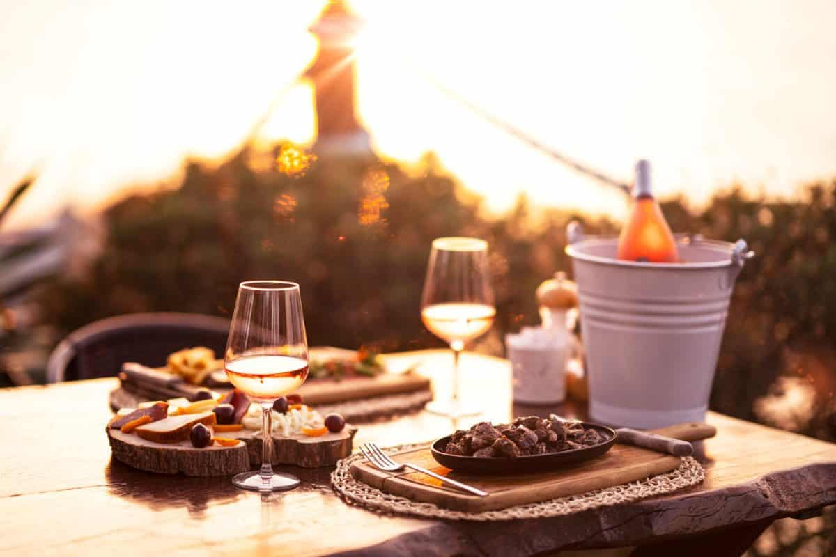 Cheese and wine platter with rose wine, Should The Wine Glass Be On The Left Or Right?
