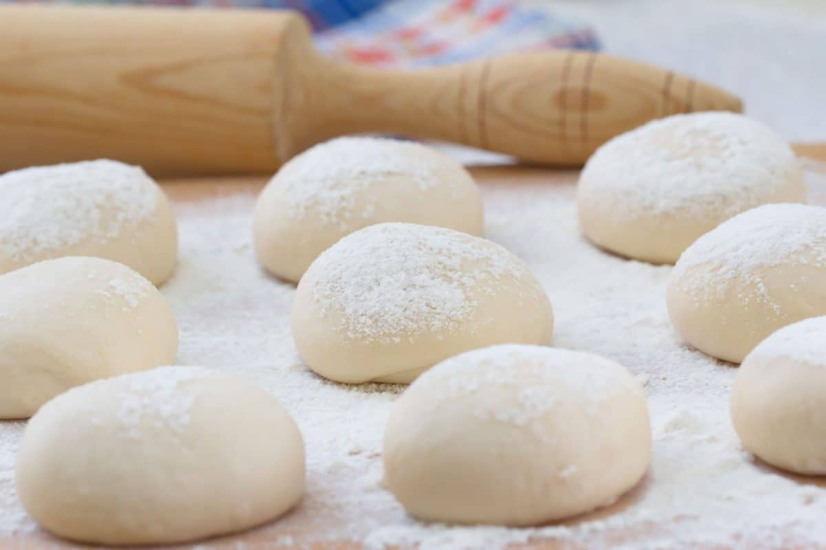 Cooking dough for pastries with a rolling pin on the back, How To Store Bread Dough Overnight [A Complete Guide]