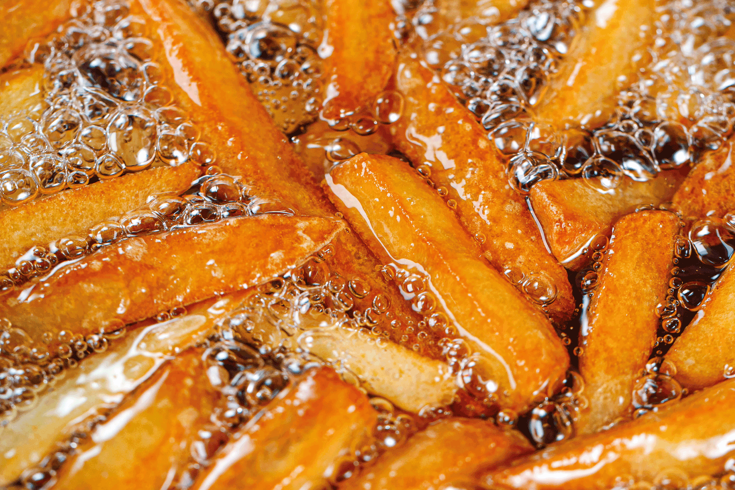 Cooking french fries in the deep fryer, crispy fries, Junk food