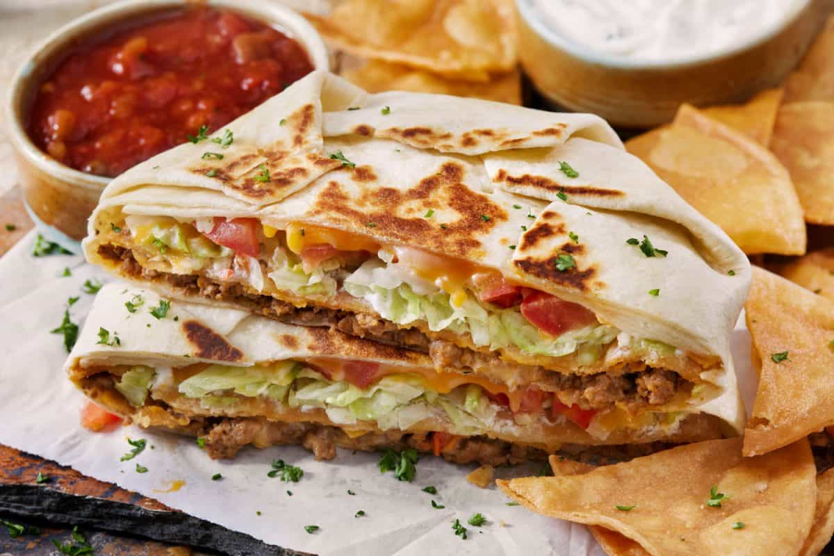 Delicious homemade tortillas with spring onions and chips, Should You Fry Flour Tortillas For Enchiladas?
