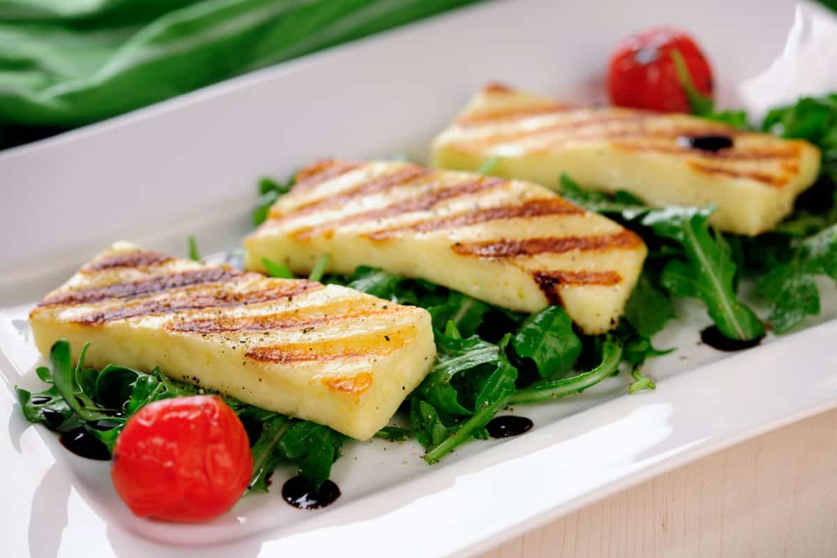 Delicious salad halloumi cheese with asparagus leaves and cherry tomatoes, Should You Cook Halloumi Cheese? [And How To!]