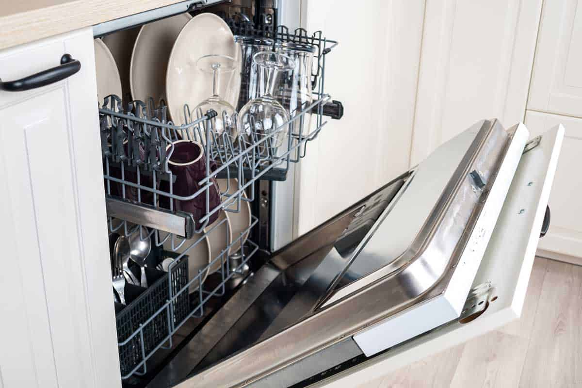 Dishwasher close-up with washed dishes, How Long Should A Bosch Dishwasher Cycle Run?