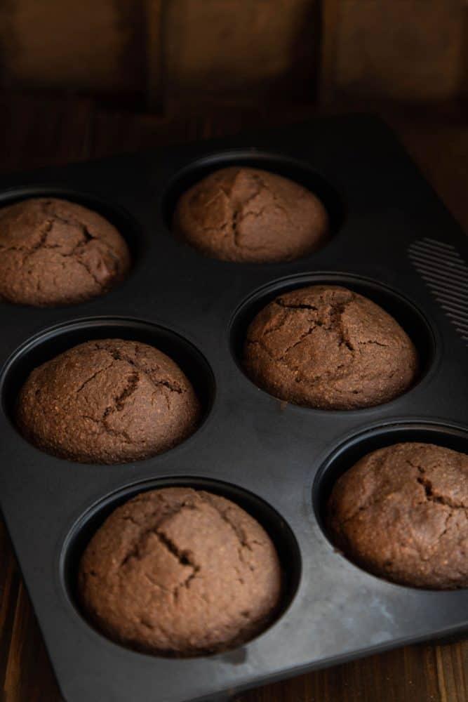 Freshy baked chocolate cupcakes in a dark pan
