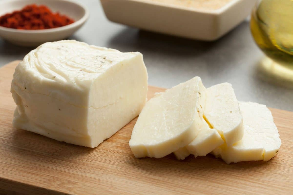 Freshly sliced halloumi cheese on the chopping board